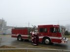 Santa and Mrs. Claus arrived courtesy of a Hazel Green Fire Department fire engine